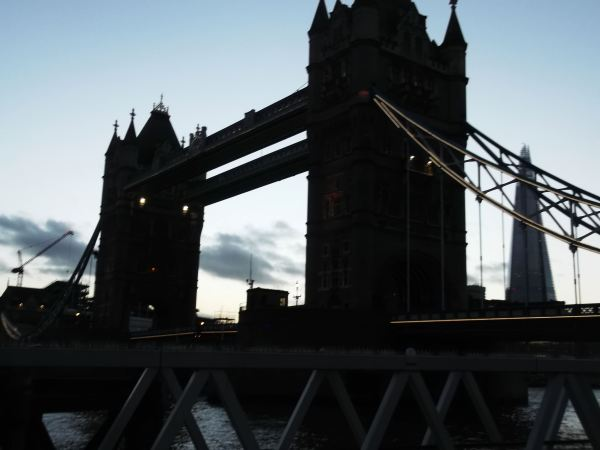 and this is tower bridge as the traffic thunders by its span of the river