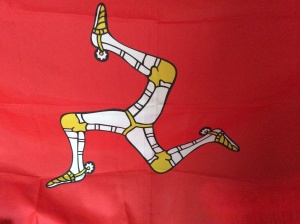 The Isle of Man flag which is between northan Ireland and England they have there own laungwich Manx and the Capitol is Douglas it's a country of wonderfull views and it's history stretches back for century's and the first preatroric writings was found there